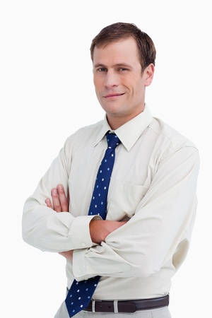 Close up of businessman with his arms crossed against a white background photo