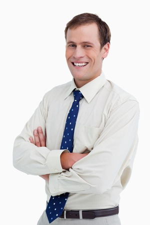 Close up of smiling businessman with arms folded against a white background photo