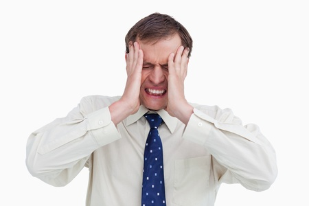 Close up of businessman with a headache against a white background photo