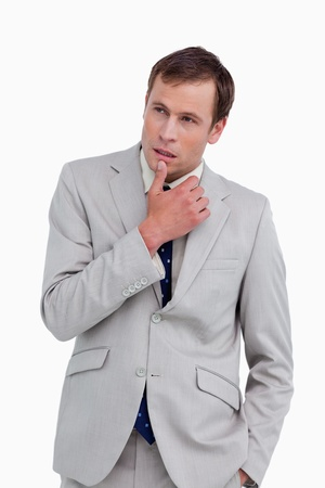 Close up of thoughtful businessman against a white background photo