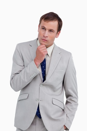 Close up of thinking businessman against a white background photo
