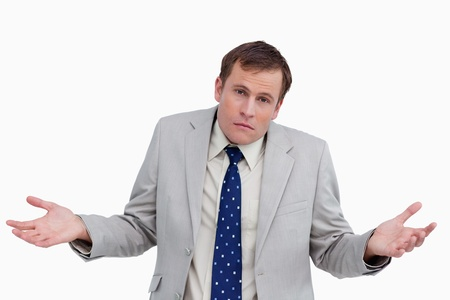 Close up of clueless businessman against a white background photo