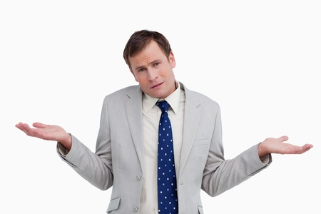 no idea: Close up of businessman having no idea against a white background Stock Photo