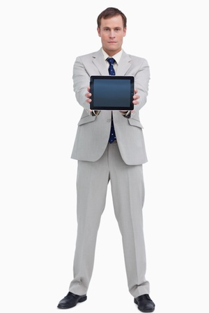 Businessman showing screen of his tablet computer against a white background photo