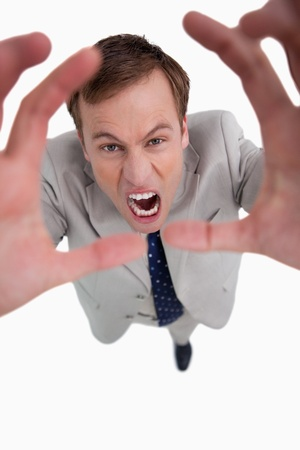 Angry yelling businessman against a white background photo