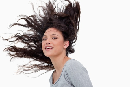 Woman with elevated hair against a white background photo
