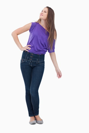 Teenager looking far ahead while her hand is on her hip Stock Photo - 13675120