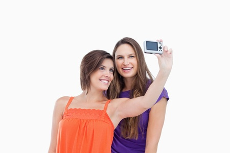 Teenager photographing herself and a friend Stock Photo - 13675104