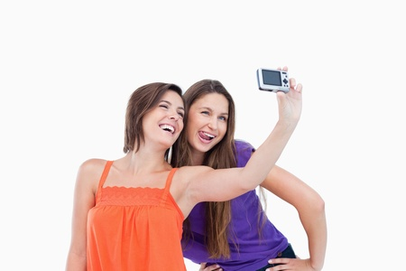 Teenagers posing and photographing themselves Stock Photo - 13675106