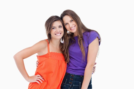 Teenagers holding each other by the waist while smiling Stock Photo - 13675034