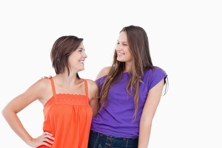 Teenagers showing beaming smiles while looking at each other Stock Photo - 13675049