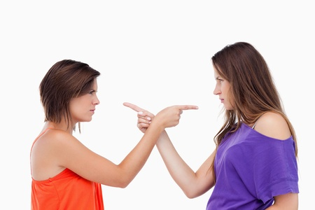 Two teenagers blaming each other while pointing their fingers Stock Photo - 13673966