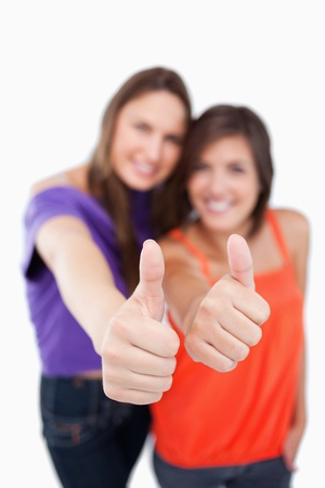 showed: Thumbs up being showed by teens with focus on their thumbs Stock Photo
