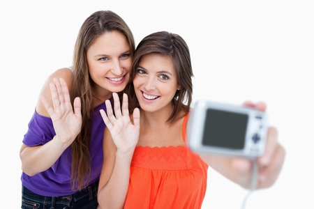 Teenagers waving in front of a digital camera Stock Photo - 13677514
