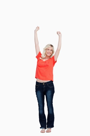 arms above head: Teenager raising her arms above the head against a white background Stock Photo