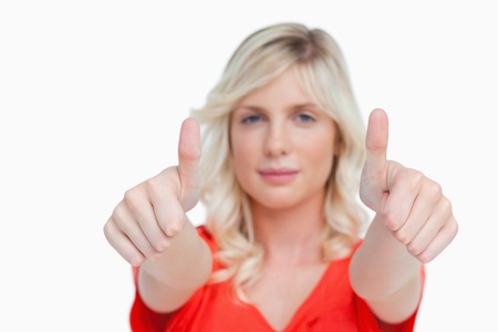 showed: Two thumbs up being showed by an attractive woman against a white background