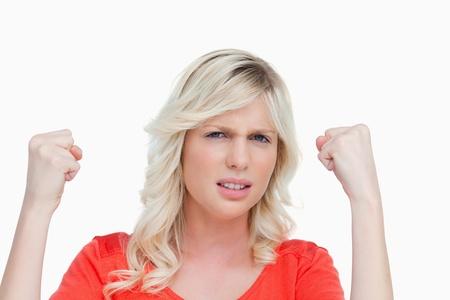 Mujer joven y atractiva muestra con orgullo su fuerza levantando los pu�os photo