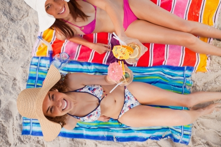 Overhead view of a woman raising an exotic cocktail with her friend next to her Stock Photo - 13670500