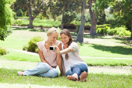 Female friends taking pictures of themselves photo