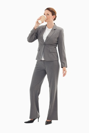 A businesswoman is drinking coffee photo