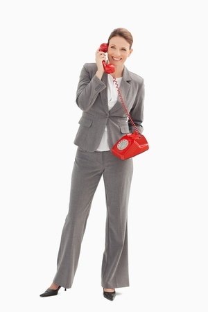 A businesswoman is talking on the phone photo
