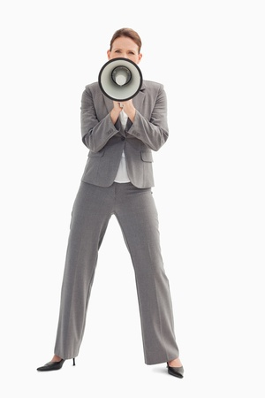 A businesswoman is holding a megaphone Stock Photo - 13674459