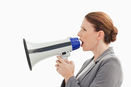 A businesswoman is talking into a megaphone photo