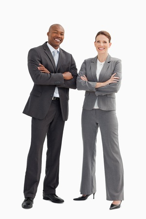 A smiling business man and woman are posing photo