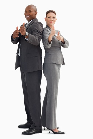 Business people who have their thumbs up photo