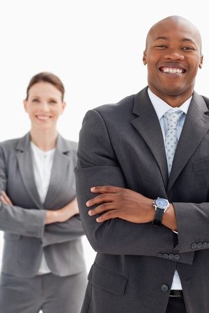Laughing businessman stands infront of businesswoman photo