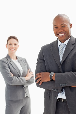 Smiling businessman and woman with their hands folded photo