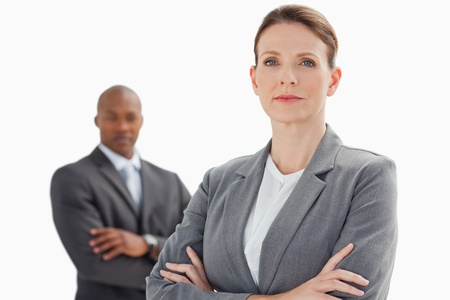 A businesswoman with folded arms stand in front of businessman with folded arms Stock Photo - 13672642