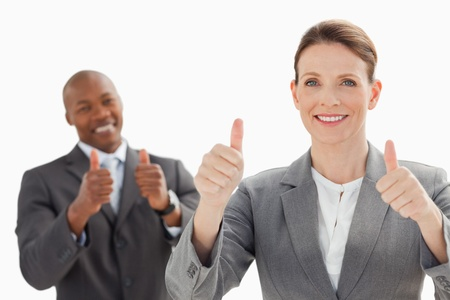 Business people are smiling with their thumbs up photo