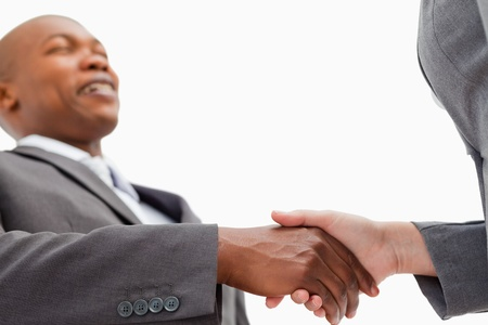 A businessman is shaking a hand photo