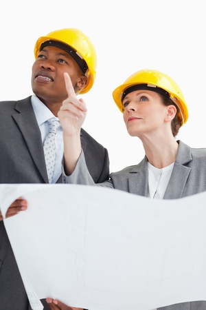hard hats: Business people are talking and wearing hard hats