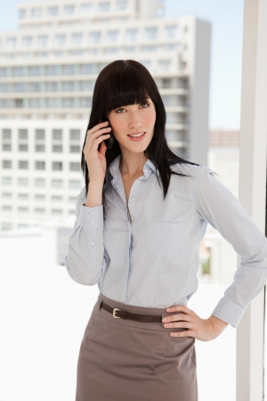 A business woman at work taking a phone call photo