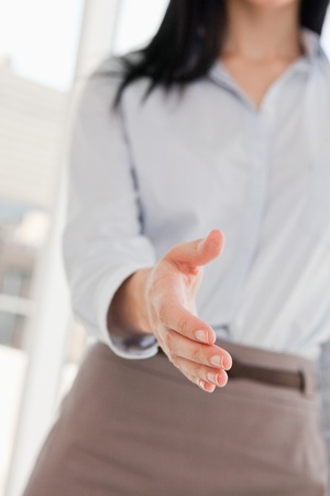 A woman offering her hand to shake Stock Photo - 13671237