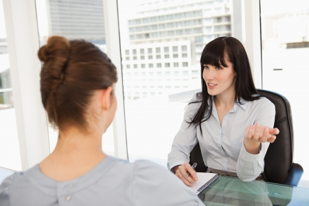 business interview: A business woman with a potential employee asks questions Stock Photo