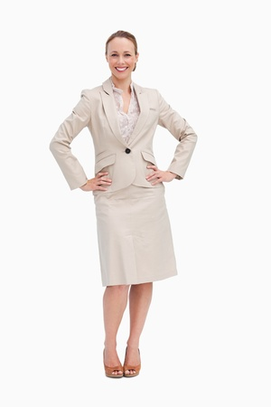 Portrait of a businesswoman with her hands on her hips against white background photo