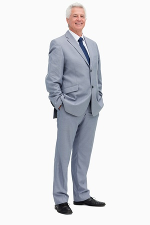Portrait of a smiling man in a suit against white babckground photo