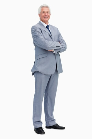 Portrait of a smiling man in a suit against white background photo