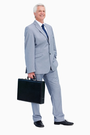 Portrait of a businessman with a suitcase against white babckground photo