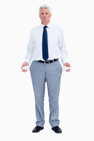 Portrait of a businessman with empty pockets against white babckground photo