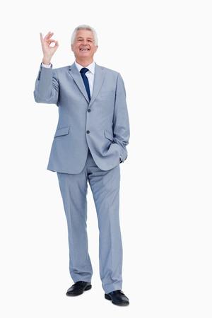 Portrait of a happy  businessman praising against white babckground Stock Photo