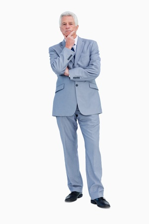 hesitating: Retrato de un hombre de negocios vacilar contra el fondo blanco Foto de archivo