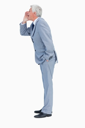 Profile of a businessman shouting against white background photo