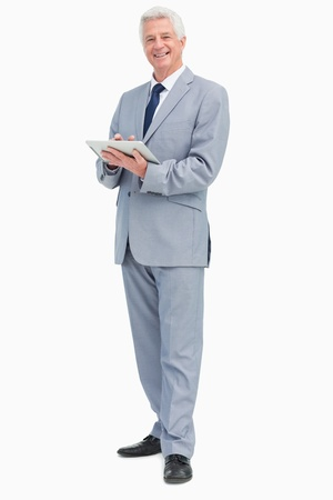 Portrait of a boss with a touch Pad against white background photo