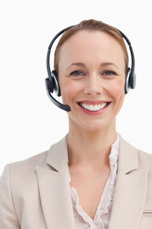 Portrait of a smiling businesswoman wearing a headset against white background Stock Photo - 13673532