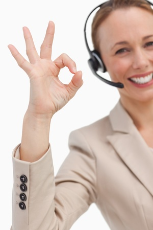 approbation: Approbation of a businesswoman with a headset against white background