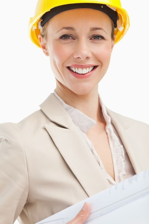 Portrait of a woman architect against white background photo